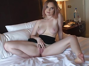 Busty nude babe in arms plays with her natural pussy in a sensual way